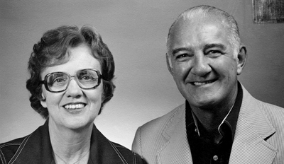 Decades ago b&w photo of Robert and Shirley Panara, head and shoulders shot smiling directly into camera