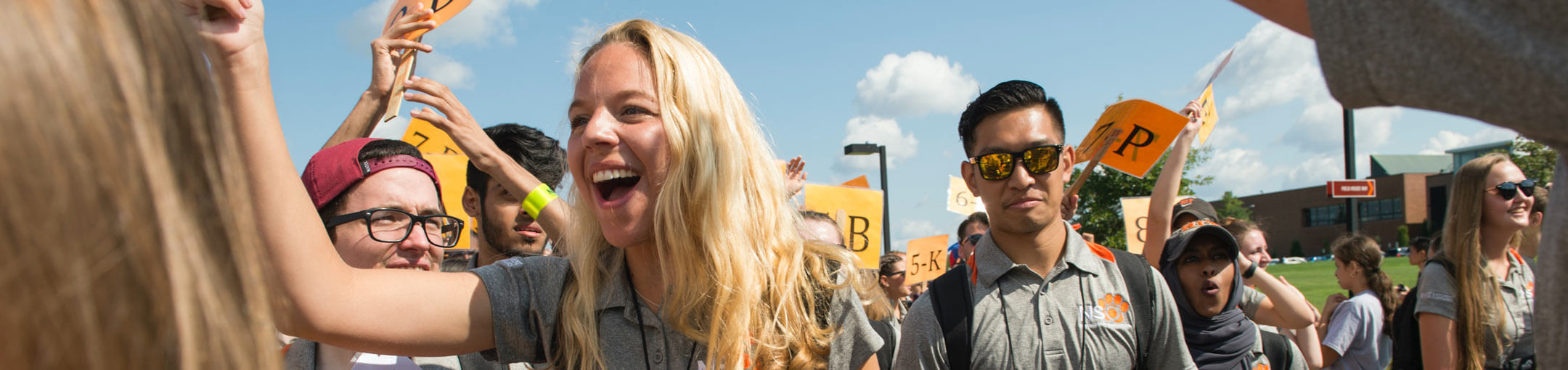 New RIT students and their orientation leaders during the Tiger Walk.
