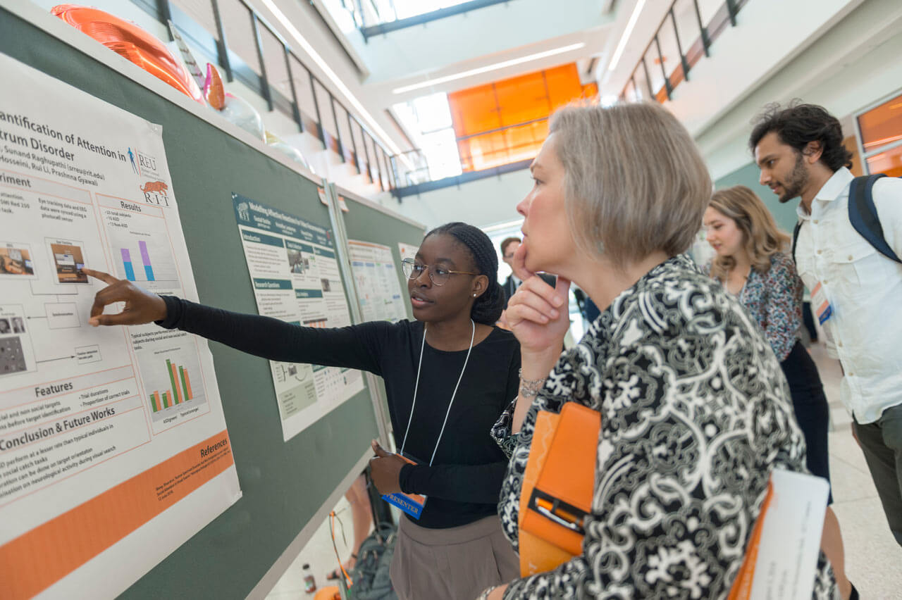 RIT students sharing their research with symposium participants at the 2018 Undergraduate Research Symposium.