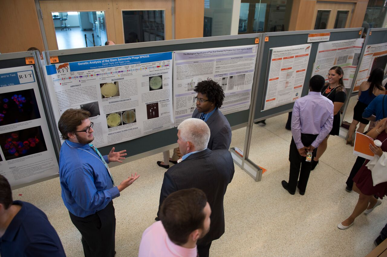 RIT students sharing their research with symposium participants at the 2015 Undergraduate Research Symposium.