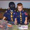 Cub scouts looking at model trains