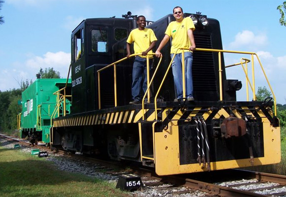 RITMRC members Luther Brefo and Mike Roqué work as conductor and engineer at the R&GVRRM.