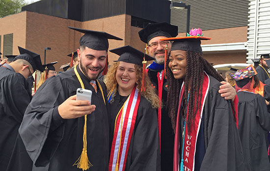 RIT grads challenged to fuse technology, humanity