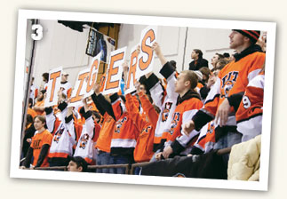 Crowd cheering at an RIT hockey game