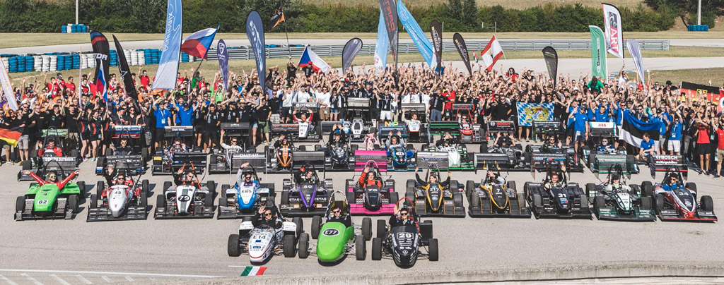 Group shot of all the cars and team members who competed in the Budapest event.
