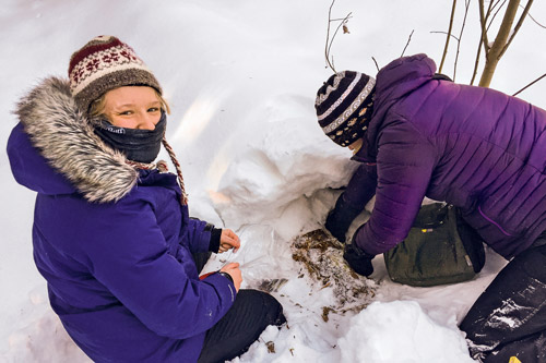 Biology student Hailey Richmond-Boudewyns, left, in the snow