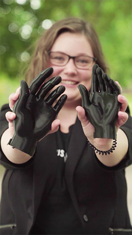 Student holding 3D printed hands