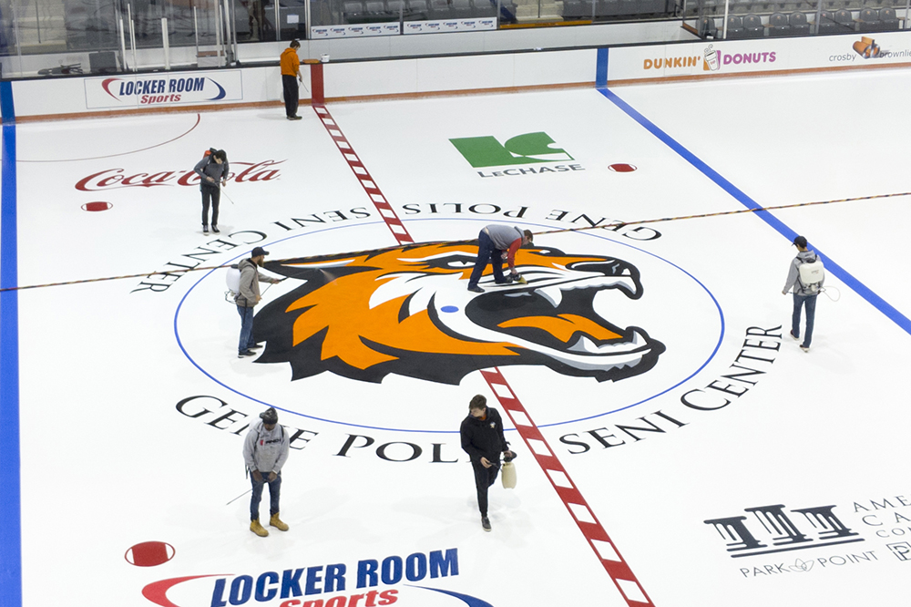 ice rink with logos and RIT Tiger