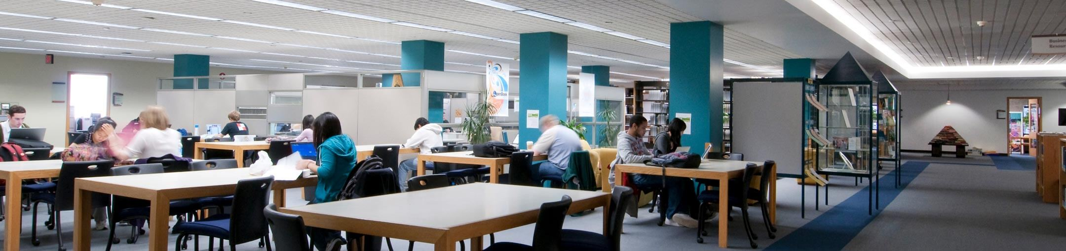 Students studying and working on projects in the library