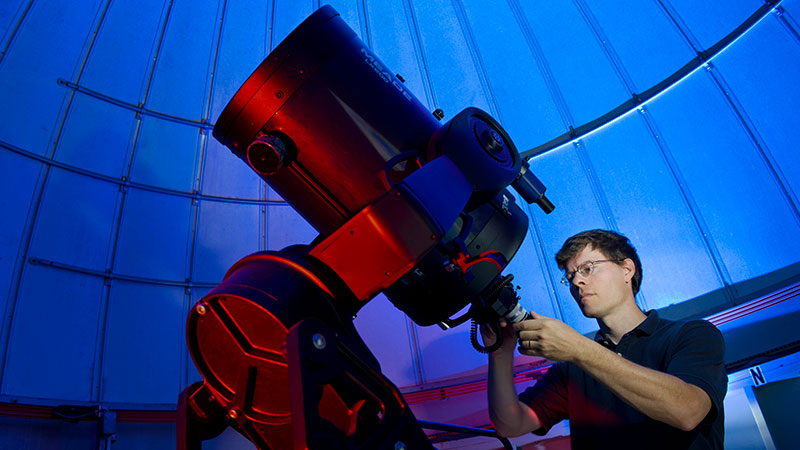 a person with a very large telescope
