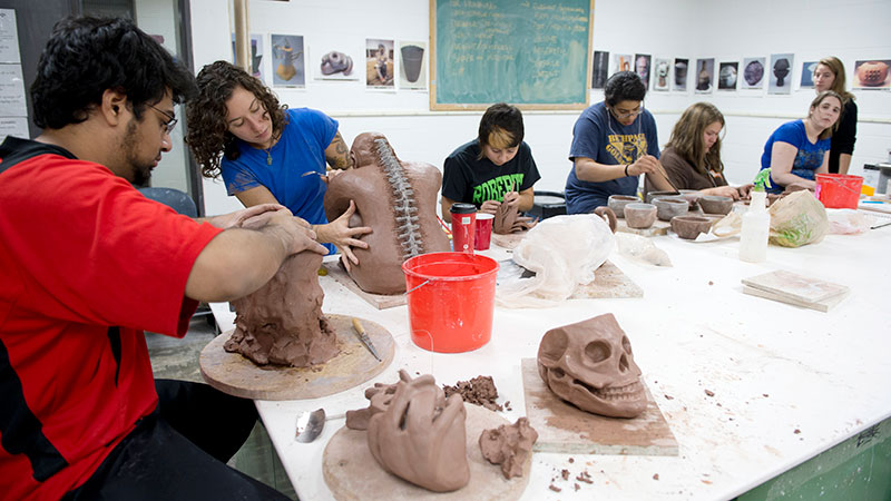 students making clay sculptures