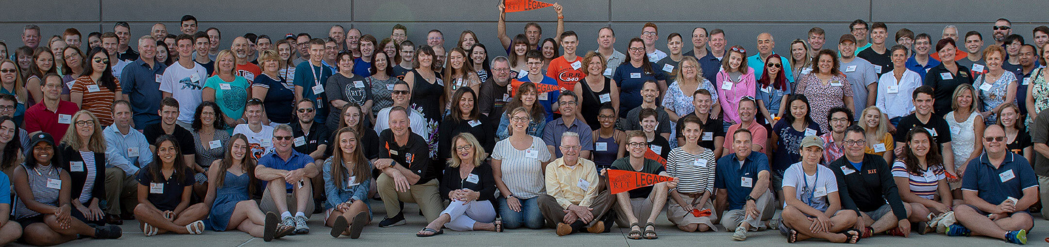 A group of incoming RIT freshmen with their parents who also attended RIT