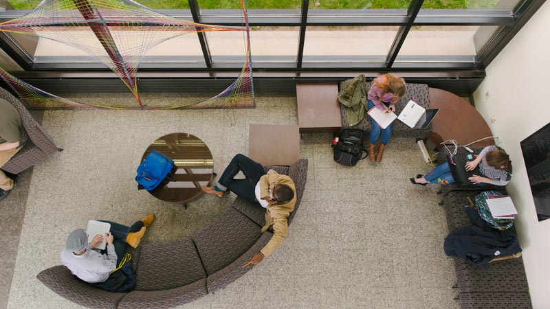 Overhead view of people sitting on office furniture
