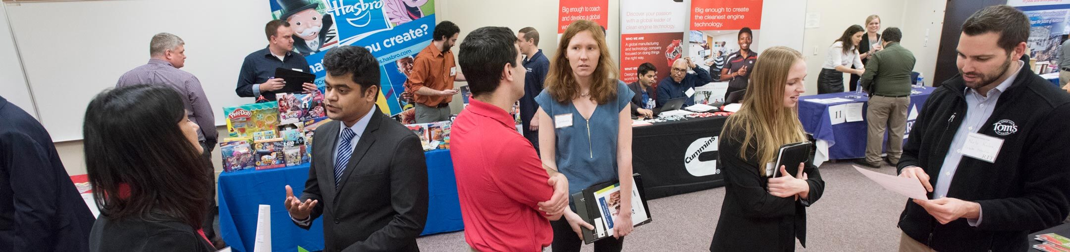 Students and potential employers talking to each other at a career fair
