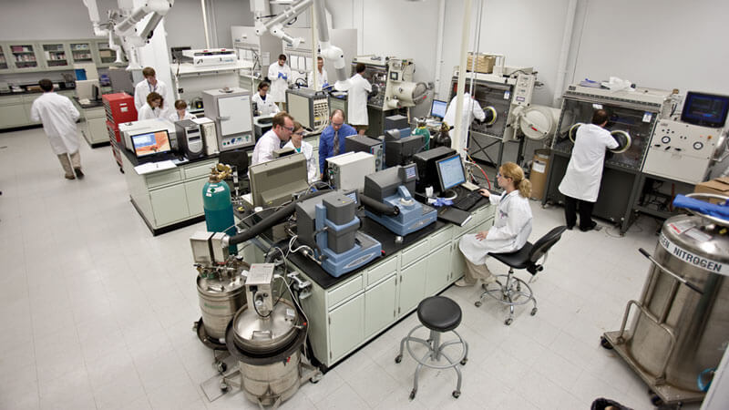 students and faculty members in a lab