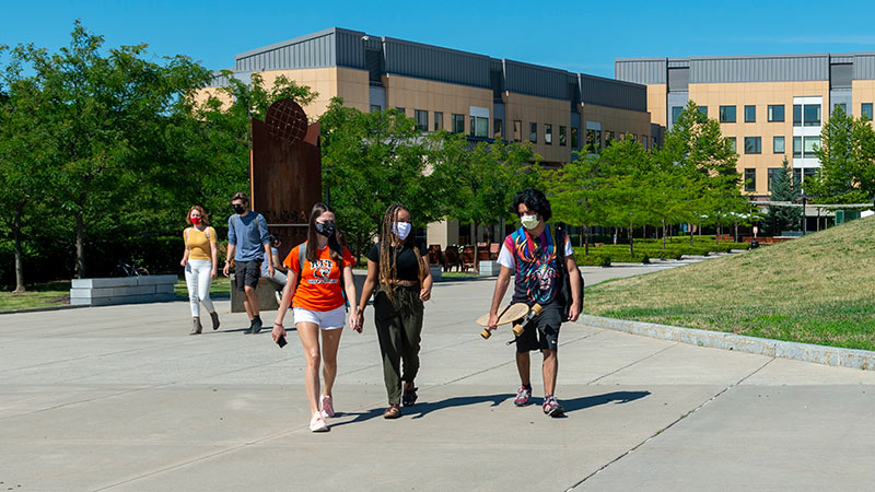 RIT students walking in masks