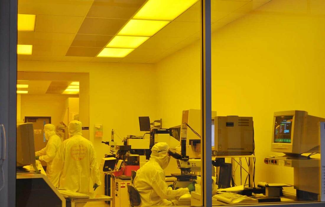 Three researchers in a clean room.