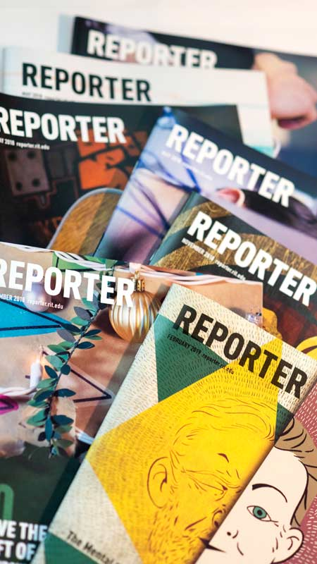 Multiple reporter magazines laid on top of one another