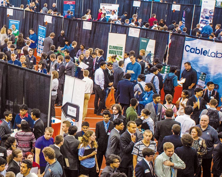 Overhead view of students and booths at an RIT career fair