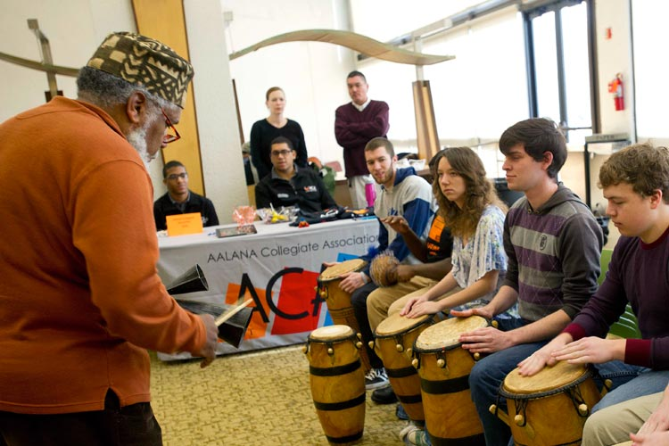 Carl Atkins performs during the multicultural drum ensemble