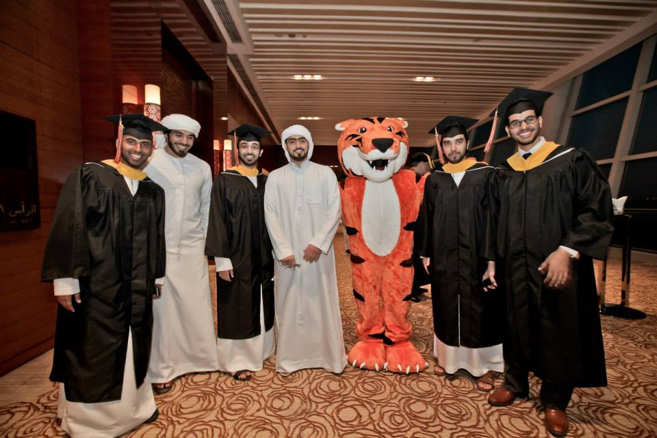Ritchie with students (some in graduation regalia) from the RIT Dubai campus