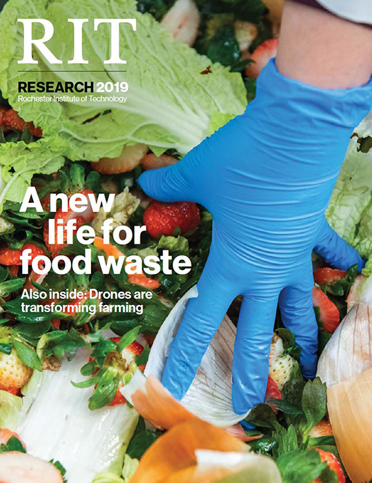 Magazine cover with photo of gloved hand grabbing food scraps.