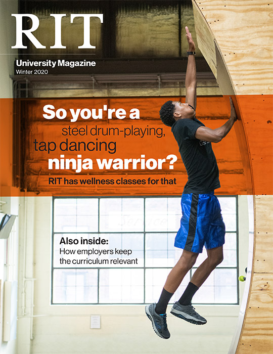 University Magazine cover featuring man reaching for top of a Warped Wall.