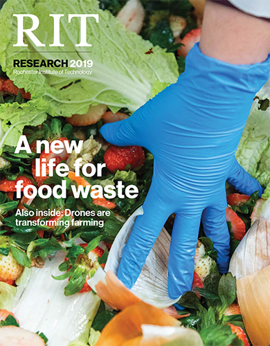 Magazine cover with image of gloved hand reaching into food scraps.