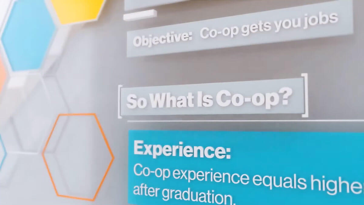 "A screenshot from a video showing hexagons on the left and text on the right saying: ""What is Co-op?"""
