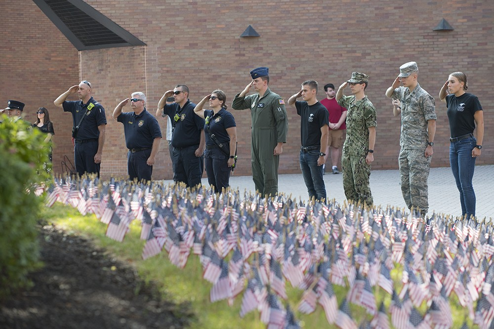 <p>RIT's Army and Air Force ROTC cadets and members of the Arnold Air Society commemorated the events of 9/11 with a vigil and Taps in front of a flag array near the Student Alumni Union. This is the eighth year the groups have hosted the event.&nbsp;</p>
