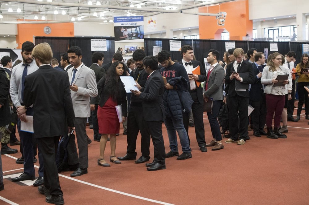 Photo by A. Sue Weisler <br> <p>Thousands of RIT students looking for co-op or full-time employment meet with recruiters from 240 businesses at today's Spring Career Fair in the Gordon Field House.</p>