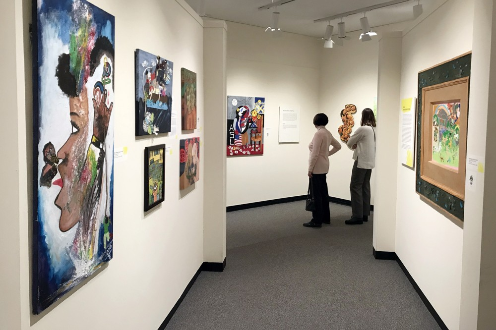 "Photo by A. Sue Weisler <br> <p><span><span><span><span><span><span><span><span><span><span><span><span><span><span><span>""De'VIA: Manifesto Comes of Age""&nbsp;exhibition at the University of Rochester's&nbsp;</span></span></span></span></span></span></span></span></span></span></span></span></span></span></span><span><span><span><span><span><span><span><span><span><span><span><span><span><span><span>Memorial Art Gallery featured work from the permanent collection of&nbsp;</span></span></span></span></span></span></span></span></span></span></span></span></span></span></span><span><span><span><span><span><span><span><span><span><span><span><span><span><span><span>RIT/NTID's Dyer Arts Center. De</span></span></span></span></span></span></span></span></span></span></span></span></span></span></span>'VIA represents a name from American Sign Language meaning Deaf View/Image Art.</p>"