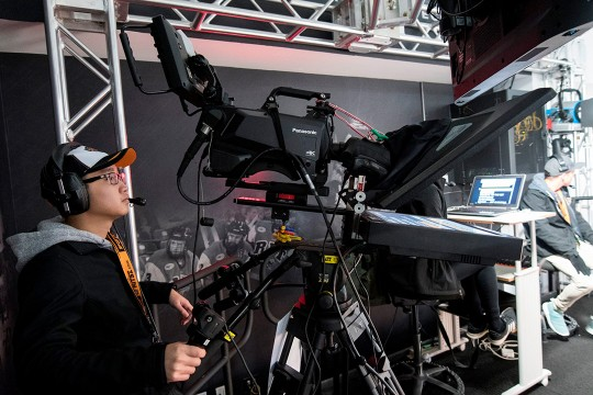Student operates camera with teleprompter