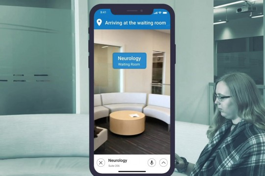 Graphic of woman sitting in waiting room in background with image of smartphone screen in foreground