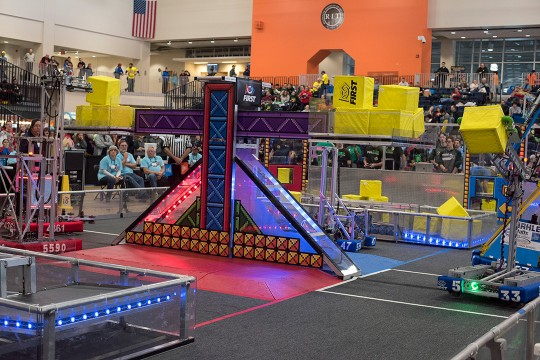 Colorful obstacle course for small, student-created robots holding yellow cubes