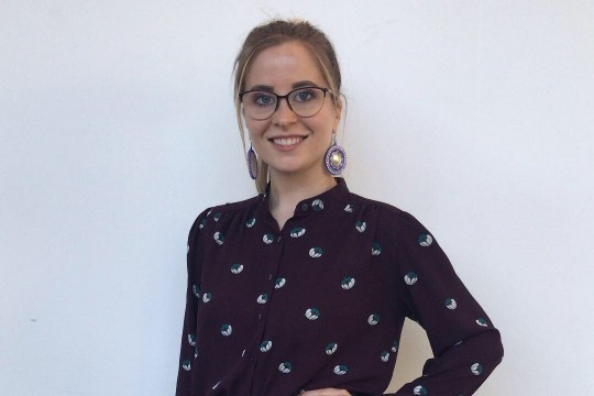 Head-and-shoulders view of student wearing glasses and purple blouse