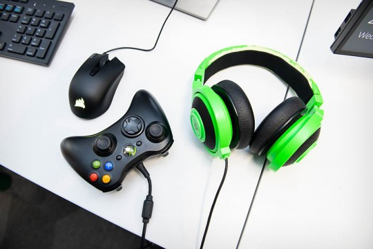 Image of computer mouse, Xbox controller and headphones