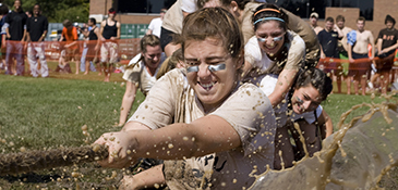 Students participating in the annual Mud Tug of War event