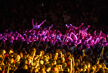 Students crowd surfing at an on campus concert