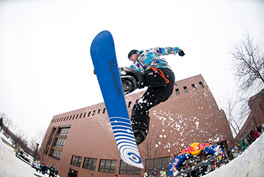 Image of a snowboarder mid air at the annual RIT Rail Jam