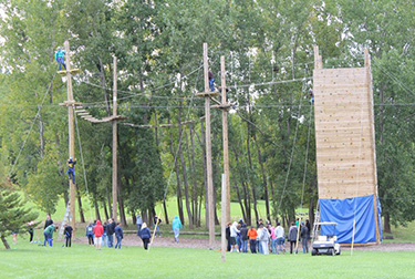 Students participating in an obstacle course