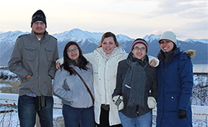 Students together with a snowy mountain in the background