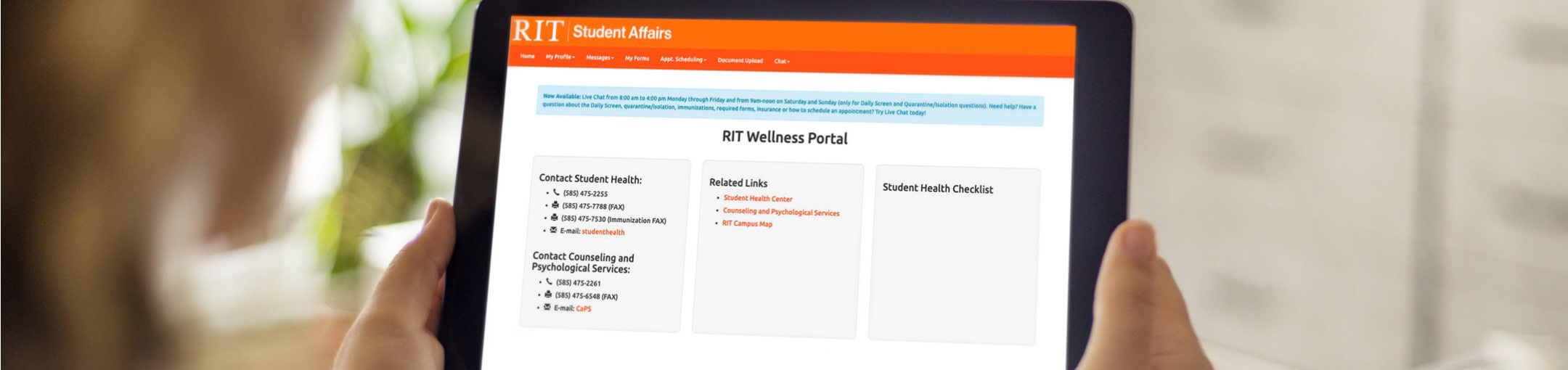 A person holding a tablet with the RIT Wellness Portal on the screen.