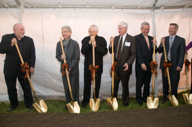 seven people with golden shovels at a breaking ground event