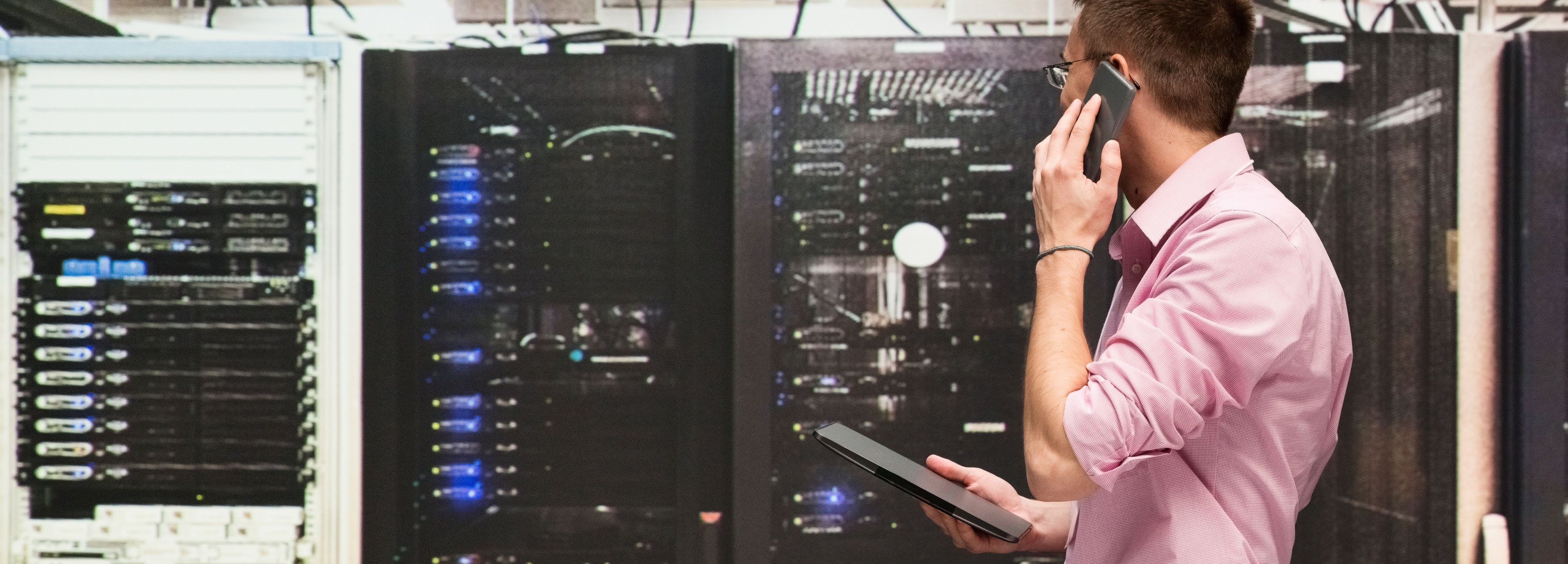Network engineer reviewing server cabinet
