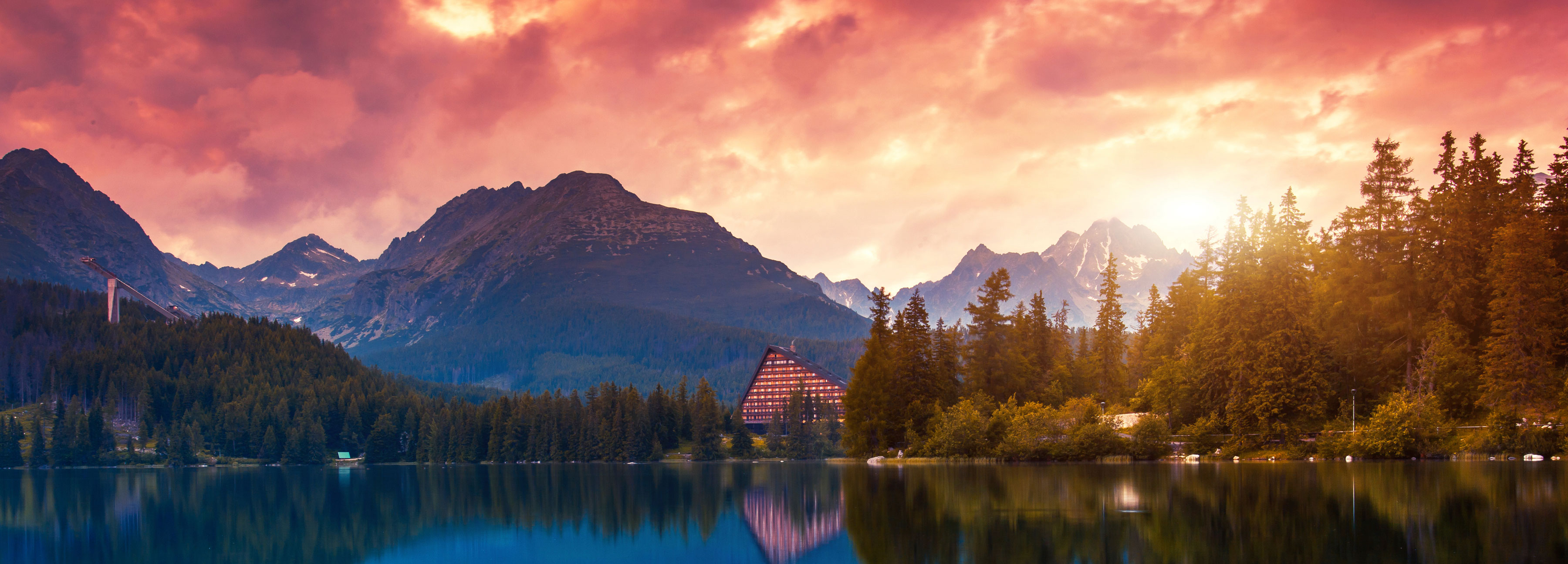 Sunset over a mountain resort and lake