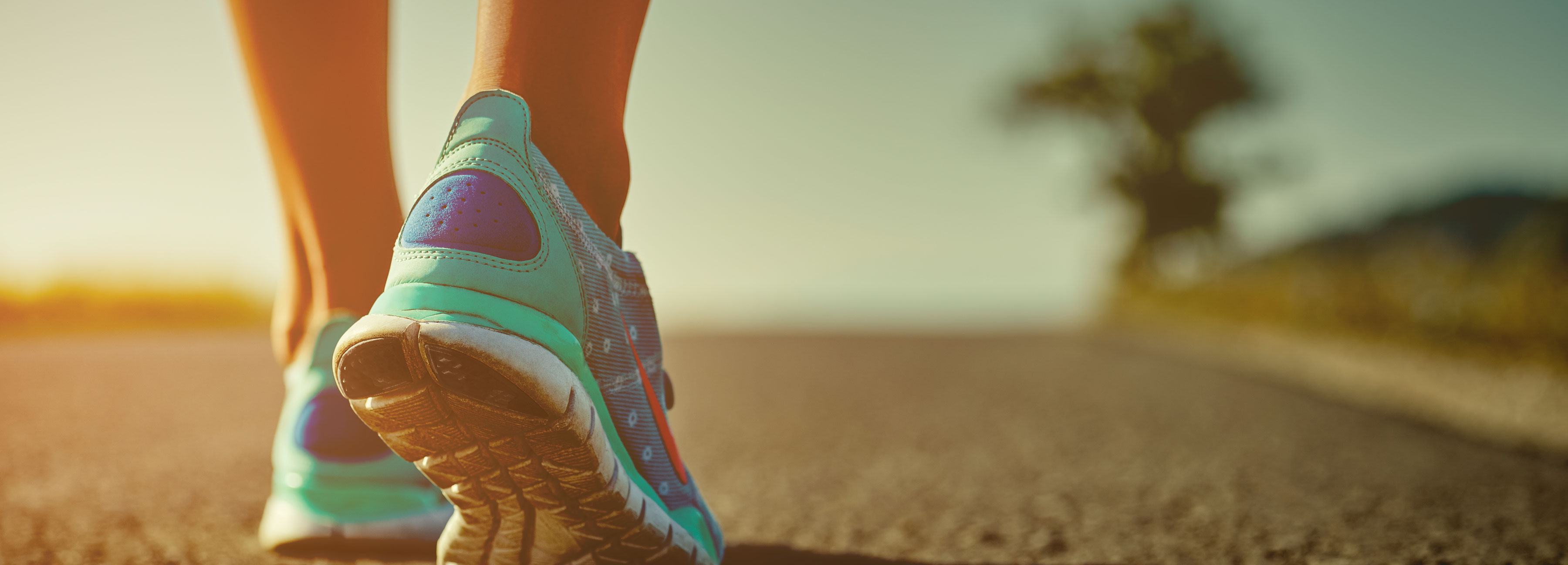 Close up of a woman in running sneakers on path