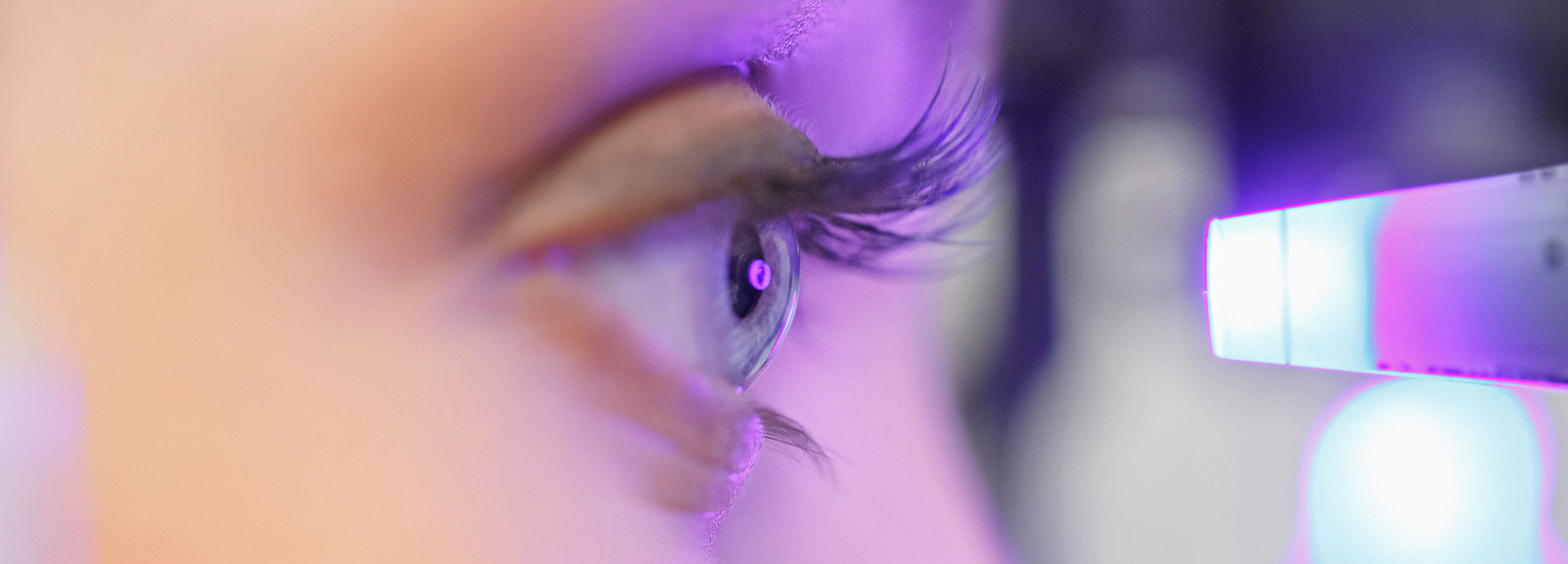 Close up of a woman's eye looking into a eye scanner
